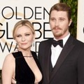 Kirsten Dunst dan Garrett Hedlund di Red Carpet Golden Globes Awards 2016